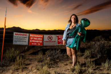 Michaela Ripley, 21, from Olympia, Wash., at the fence to Area 51 in Rachel, Nev., Sept. 20, 2019. (Roger Kisby/The New York Times)