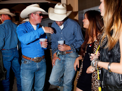 Cowboys flirting with  young women at the Pendleton Roundup