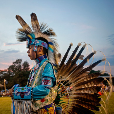 Lucky, 10 from the Shawnee tribe, in traditional dress. Oklahoma, USA
