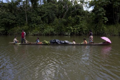 An Embera family on the Bete river, Choc√≥, Colombia, November 21, 2014. A rain-drenched pocket of rivers and jungles that'Äôs overwhelmingly home to Afro-Colombians and indigenous groups, this province became ground zero in Colombia'Äôs 50-year-old struggle against Marxist guerrillas last week, when FARC rebels snatched Colombian Army General Ruben Dario Alzate and two others from the riverside enclave of Las Mercedes. The capture triggered the suspension of two-year old peace negotiations between the Colombian government and Revolutionary Armed Forces of Colombia, which had been underway in Havana, Cuba, as the two sides hash out the terms of the general'Äôs release.