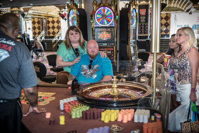 "Las Vegas, NV-2015 April 24, 2015-Guests gamble at the roulette wheel. The Riviera Hotel and Casino, which opened in 1955, will be shut down permanently on May 4, 2015 and the building imploded in late summer 2015.The Riviera was the first high-rise hotel built on the Strip as was expanded in subsequent decades. It is the last of the hotels from that era still in its original form. Many of the major U.S. entertainers of the last several decades played at the hotel including Elvis Presley, Liberace, Frank Sinatra, Dean Martin, Steve Martin and many others.The hotel has been used for the filming of many movies including the original ""Oceans Eleven"", ""The Hangover"" and it was the chief model and shooting location for Martin Scorsese's ""Casino.""The hotel was privately-owned before recently becoming bankrupt. It was then purchased by a Nevada state agency, the Las Vegas Convention and Visitor's Bureau which chose to demolish the hotel to make room for more convention space in the city.Photo by David Butow"