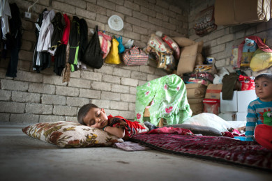 Yazidi refugees living in unfinished buildings, Iraqi Kurdistan Imke Lass/Redux Pictures