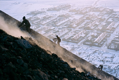 China - Heilongjiang - Qitaihe, Villagers scavage coal from slag mountain for home heat.