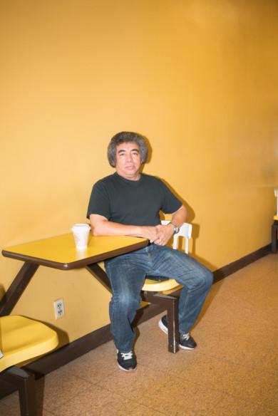 Man portrait donut shop yellow wall