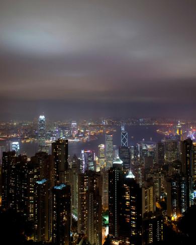 The skyline of Hong Kong at night. Photo by Kevin J. Miyazaki/Redux