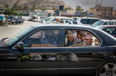 A car drives by,  Nizwa Souk and Cattle Market, Oman