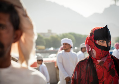 Man and women at the Nizwa Souk and Cattle Market, Oman