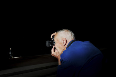 Bill Cunningham photographs a model at the Marc Jacobs show, New York City.