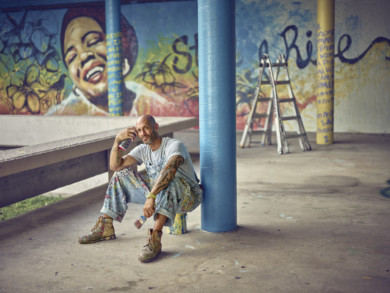 portrait of Colgate alumnus German DuBois. He is a spraypaint muralist, and our article is about his art program for teens in the Miami  juvenile detention center.