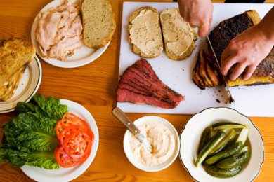 Assembling a Pastrami Club sandwich at Kenny and Zukes in Portland Oregon