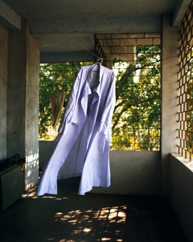Priest's robe blowing in the wind, Kerala - India