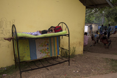 An african illegal immigrant sleeps at Masdil camp, a detention center for, mainly, illegal immigrants from Africa and South East Asian citizens who enter Panama through the Darien gap jungle in Colombia. Meteti, Panama, March 31, 2015. For the last three years Panama has experienced a huge migration wave of Cuban, Somalis, Nepalese, Pakistanies and Sri Lankan citizens who first arrive in Ecuador, Brazil or Guyana and then move by land throughout Colombia to arrive in Panama where they get transit visas and then head up north of the continent towards USA.