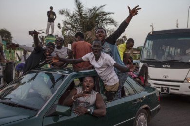 Gambians celebrate after President Barrow is sworn into office