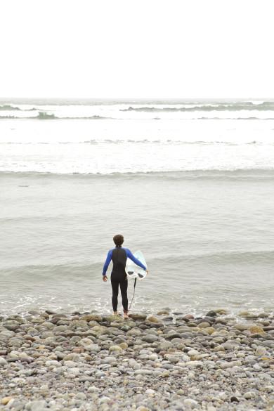 Surfers, coast of Lima, Peru