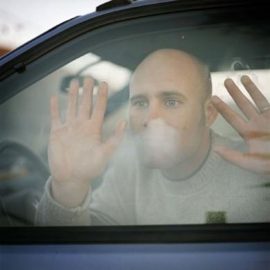 Fresno California. David Lauridsen Photographer in his car