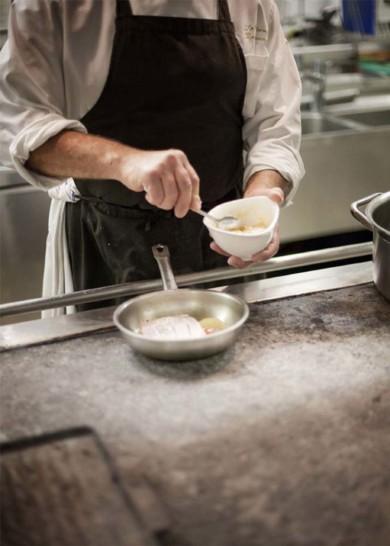 Pitigliano, Summer 2010 - A cook in his kitchen prepares a pasta dish