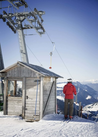 Seiss Sud Tirol. A skier gets ready for the next slope