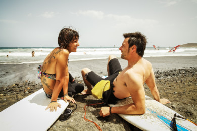 Spanien, Canary Islands, Tenerifa , Surfer bei El Medano